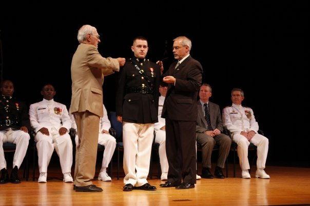 My dad and my granddad pinning my brother during his commissioning.
