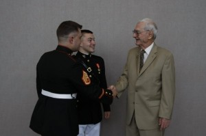 My brother and I shaking the hand of my grandfather.